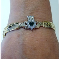 Image for Rolled Gold Cluster Embossed Claddagh Bangle